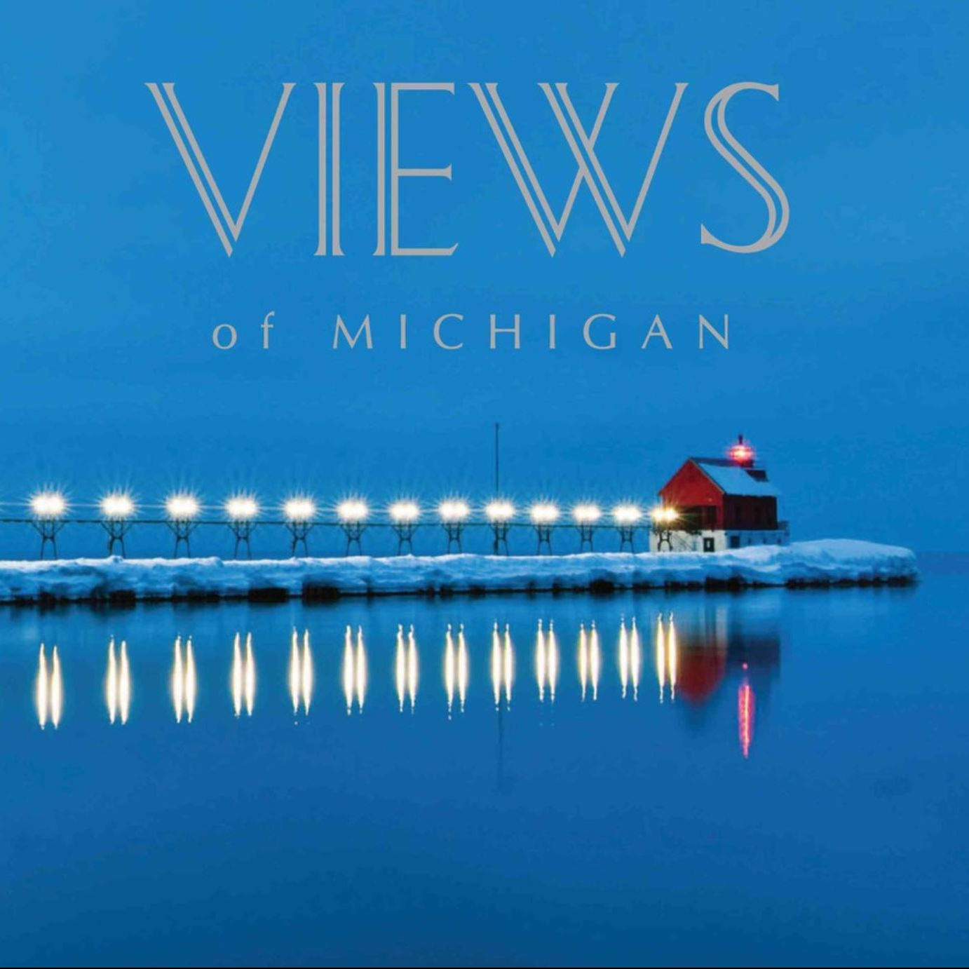 A blue book cover featuring a red lighthouse over water on a winter evening.