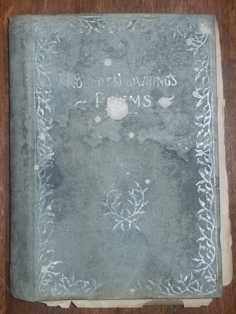 A worn book of Robert Browning's Poems.